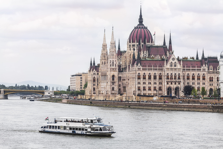 pleasure boat: Hungarian parliament building on the Danube and a pleasure boat on the river. Budapest. Hungary