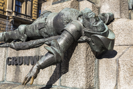 defeated: KRAKOW, POLAND - OKTOBER 28, 2015: A figure of a defeated knight on the monument to the battle of Grunwald in  Krakow. Poland
