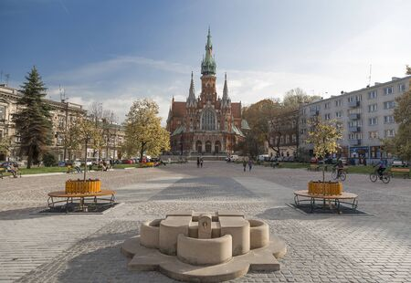 st  joseph: KRAKOW, POLAND - 26 October 2015: The Old Market Square and the Cathedral of St. Joseph