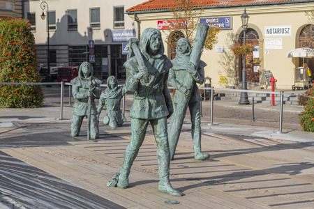 miners: WIELICZKA, POLAND - OCTOBER 26, 2015: Sculpture miners coming out of the underground Wieliczka Salt Mine. Poland