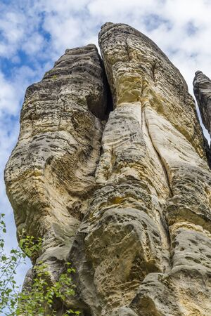 steep cliffs: Vertical steep cliffs in the Bohemian Paradise on a background of blue sky with clouds. Czech Republic Stock Photo