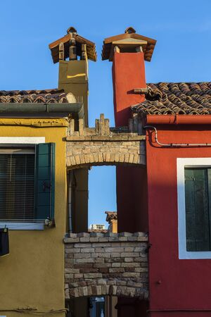 Chimneys of two adjacent houses on the island of Burano. Italy