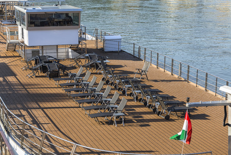 pleasure craft: Upper deck pleasure craft with folding deck chairs for relaxation Stock Photo
