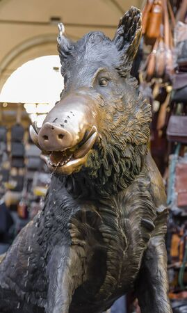 Sculpture of a wild boar, which is a fountain in the old market area of Florence. Italy