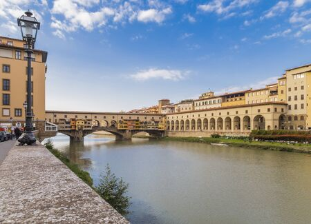 river arno: Old bridge over the river Arno - Ponte Vecchio and the historical architecture on the shores. Florence. Italy Stock Photo