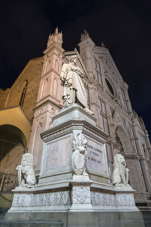 dante alighieri: Sculpture of Dante Alighieri in the background of the Basilica of Santa Croce and the night sky. Florence. Italy Stock Photo