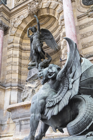 Detail of the fountain in the Plaza of St. Michael - the sculpture of the Archangel with a sword. Paris. France