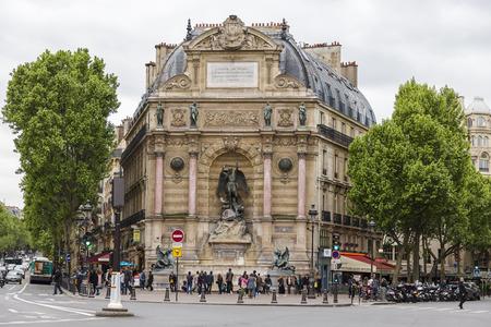 PARIS, FRANCE - MAY 18, 2016: Place Saint-Michel with ancient fountain, Paris Editorial