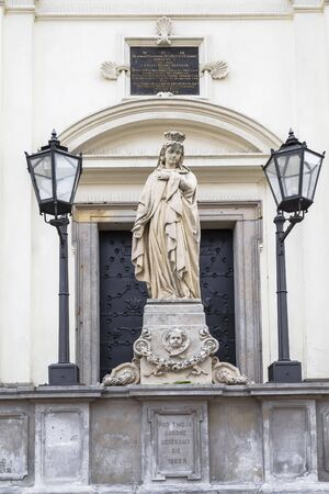 The sculpture of the Virgin in front of the Church of the Holy Spirit in Warsaw. Poland. Stock Photo