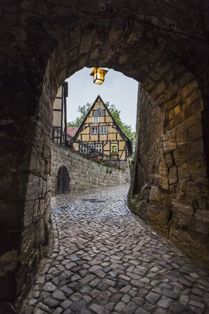Passage in the wall of an ancient monastery on the road to the church of St. Servatius. Quedlinburg. Germany Stock Photo