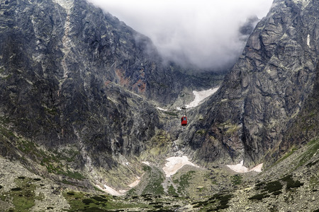Cabin lift moves between the mountains to the top. Tatra. Slovakia