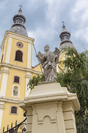 Sculpture of the Archangel Michael in front of Cistercian Church in Eger. Hungary