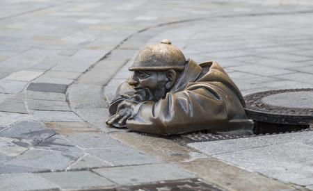 BRATISLAVA, SLOVAKIA - JULY 27, 2016: Bronze sculpture of a plumber or the person at work, Bratislava, Slovakia
