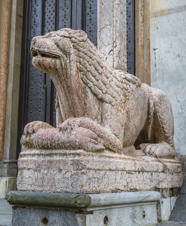 Sculpture of a lion in front of the Cathedral of Cremona. Italy