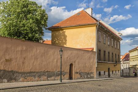 Urban landscape - the street Loretanska, picturesque buildings, walls and wood. Prague. Czech Republic Editorial