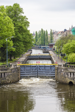 The gateway system in the city on the Vltava river in the process of pumping water