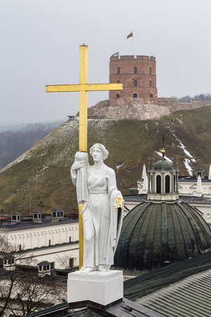 Sculpture of St. Helena with the cross on the cathedral. Vilnius. Lithuania Stock Photo