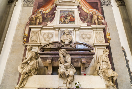 FLORENCE, ITALY - OCTOBER 29, 2014: Detail of Michelangelo tombstones in the Basilica of Santa Croce in Florence.