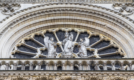 Virgin Mary with Two Angels is located in the center of the main stained glass rose-Notre-Dame de Paris. Paris. France Stock Photo - 67734132