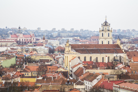 vilnius: View of the city from the observation deck at Tower of Gediminas on a cloudy day. Vilnius. Lithuania