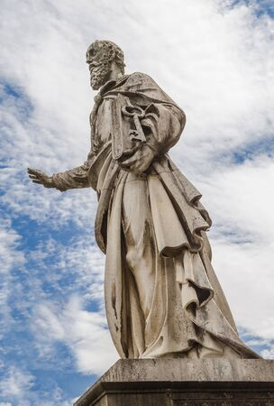 The sculpture of the Apostle Peter in front of the Basilica of St. John the Apostle and Evangelist, St. Michael and the Immaculate Conception in the city of Eger. Hungary
