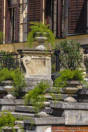 Large concrete vases with ornamental plants stand on the stairs parapets Stock Photo