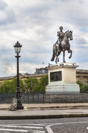 PARIS, FRANCE - May 17, 2016: Henrici Magni statue near Pont Neuf in Paris, France. Editorial