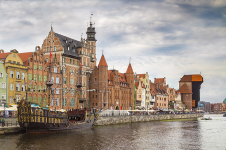 GDANSK, POLAND - AUGUST 02, 2017: Embankment of the river with pleasure boats and yachts, an excursion pirate ship and the construction of the XV century - Zhurav Editorial