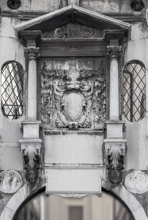 Fragment of the wall with a decorative canopy and bas-relief. Brescia. Italy