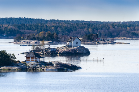 Small rocky islets (Skerries, skerry) in the Baltic Sea in Finland with small economic buildings