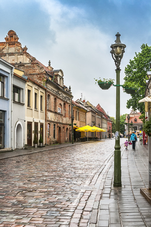 KAUNAS, LITHUANIA - MAY 17, 2012: View of Vilniaus street towards the Town Hall Square in the area of houses 6-10 with a shiny pavement from the recent rain.