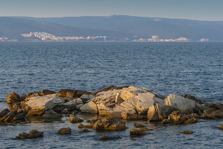Landscape with rocky boulders sticking out of the Black Sea. Nessebar. Bulgaria