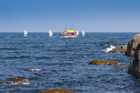SOZOPOL, BULGARIA - JULY 27, 2011: Walking along the Black Sea on a pirate yacht and small sailboats. Sozopol. Bulgaria. Editorial