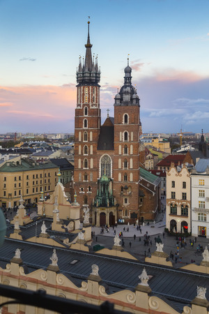 KRAKOW, POLAND - OCTOBER 30, 2018: Church of Our Lady Assumed into Heaven (also known as Saint Marys Church) is a Brick Gothic church adjacent to the Main Market Square in Krakow, Poland.