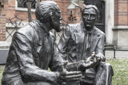 KRAKOV, POLAND - NOVEMBER 01, 2017: Sculptural composition at Krakow Planty - two outstanding mathematicians Stefan Banach and Otto Nikodim sit on a bench. ??????? 14, 2016, by sculptor ?????? Douza.