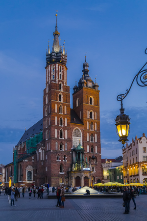 Mariacki church and market square at sunset in the city of Krakow. Poland