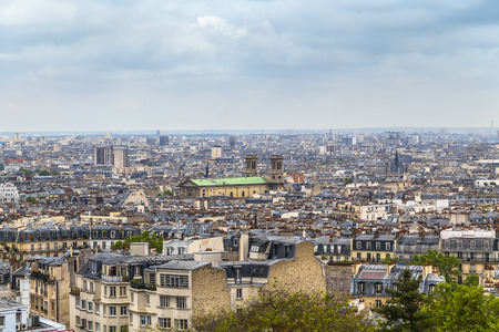 Roofs of houses in Paris - View of Paris from the Montmartre hill in cloudy weather Stock Photo