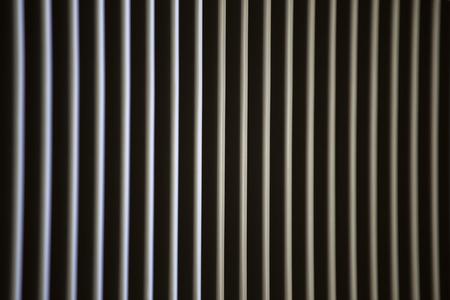 light strips through the blinds Фото со стока