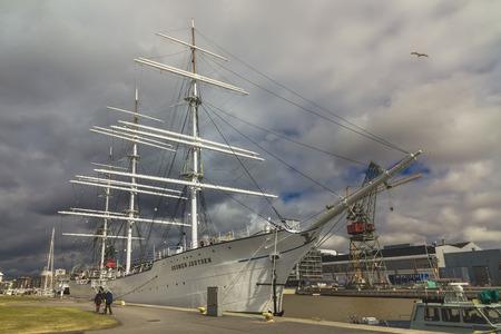 TURKU, FINLAND - APRIL 30, 2017: Three-mast sailing frigate SUOMEN JOUTSEN at the pier of the Aura River in the city of Turku