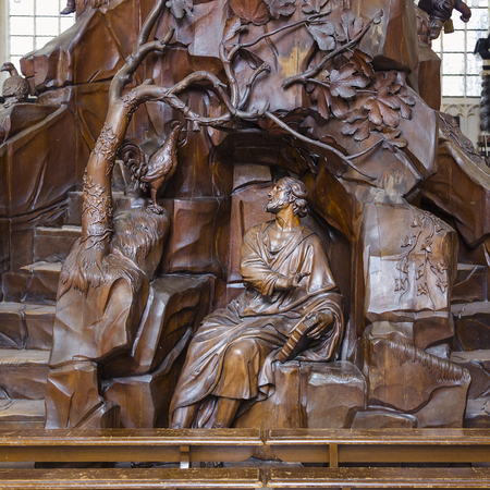 Leuven, Belgium - Fragment of a carved wooden chair in the church of St. Peter in Leuven