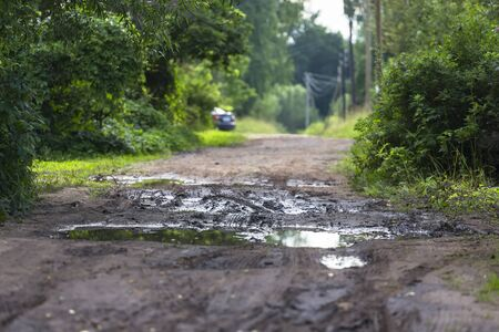 Typical dirt road in the villages of the tiyer region and in general in Russia Stock Photo