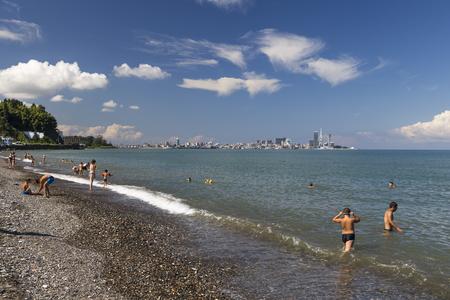 Batumi, Georgia - August 14, 2019: Embankment of the Black Sea with bathing people