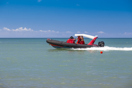 Batumi, Georgia - August 14, 2018: Rescuers patrol the coastline and beach on a motorboat in the scorching sun. Editorial