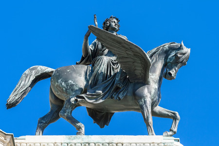 The statue of the muse of poetry on horseback Erato on the facade of the Vienna Opera