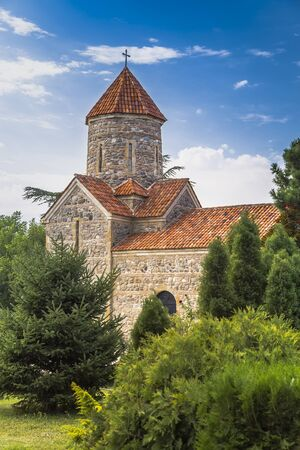 Gori, Georgia - Temple of the Holy Archangels in I. Gogebashvili Garden on a background of blue sky with clouds