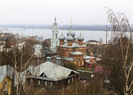 Kostroma, Russia - Church of the Resurrection of Christ and the bell tower of the Znamensky Convent on the background of the Volga River