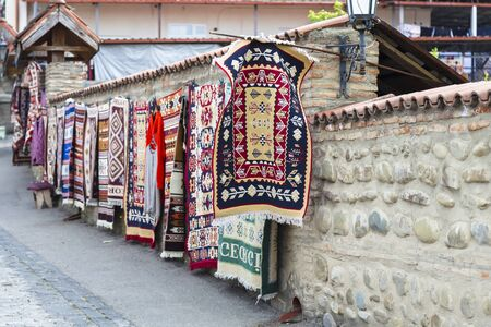 Sighnaghi, Georgia - Sale of carpets with Georgian national patterns as souvenirs on the street of the old city