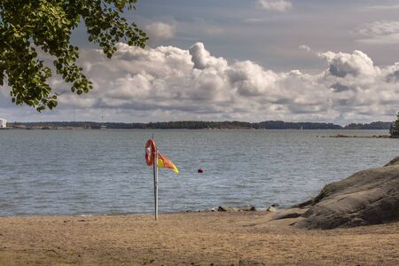 Helsinki, Finland - One of the city beaches on the Baltic coast, life buoy, relief clouds in the sky Stock fotó