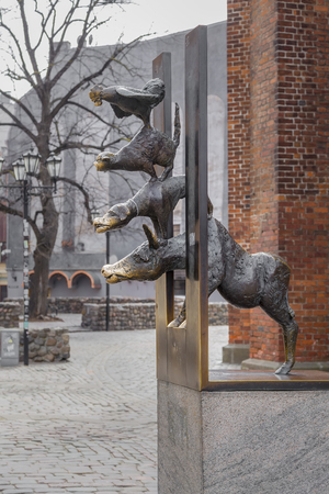 Riga, Latvia - March 28, 2019: Monument to the Bremen Town Musicians on a cloudy fall afternoon near St. Peters Church in Riga
