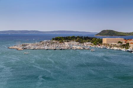 Split, Croatia - Mooring for sailing yachts and motor boats against the sea on a sunny day